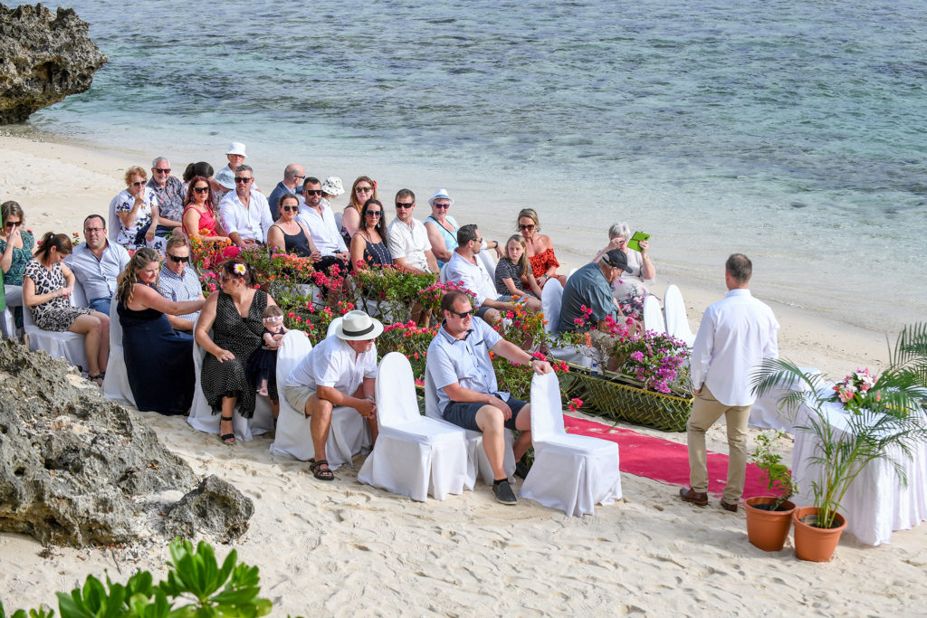 The wedding guests wait on the shores of Shangri La Fiji