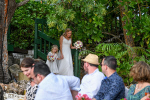 Guests watch as the bride and flowergirl make their way down the aisle