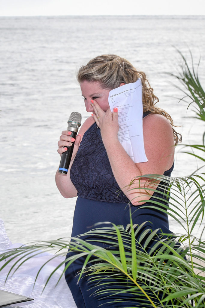 The celebrant wipes a sneaky tear as she officiates the wedding ceremony