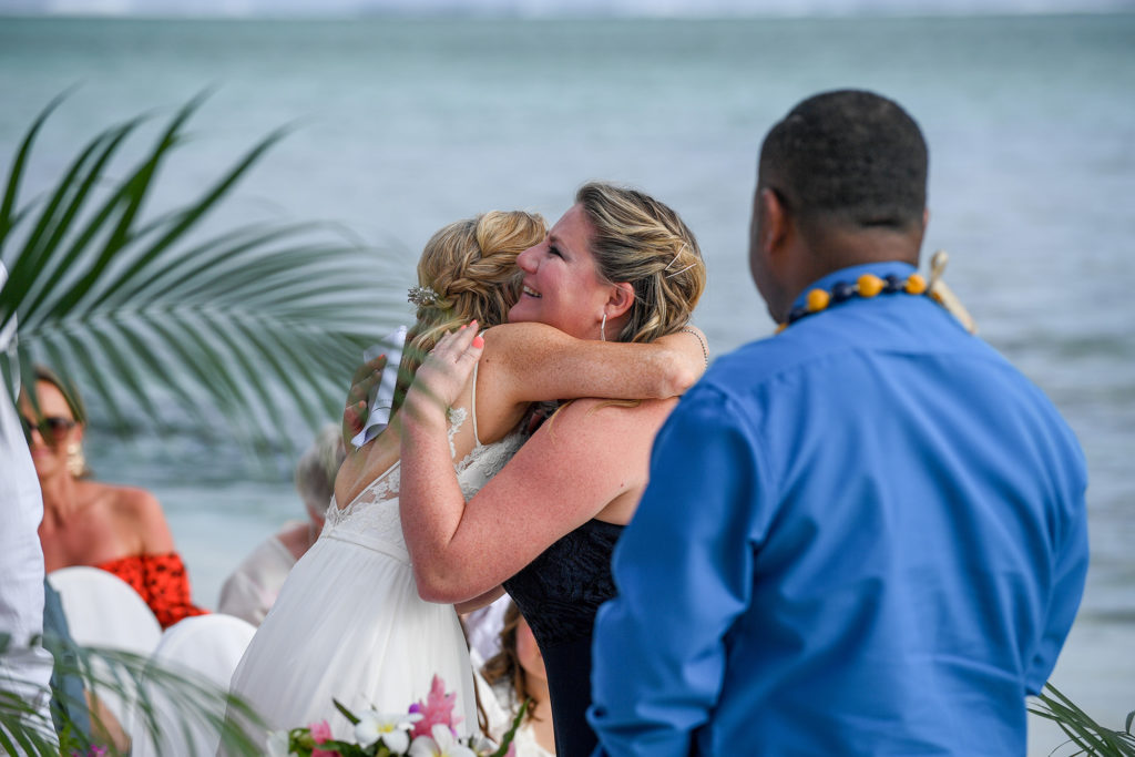 The bride hugs the celebrant