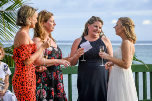 The bride catches up with her friends at the wharf of Shangri La Fiji