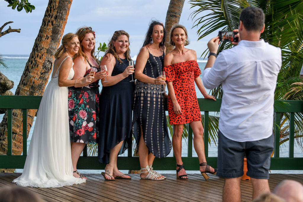 Wedding guests pose for a group photograph