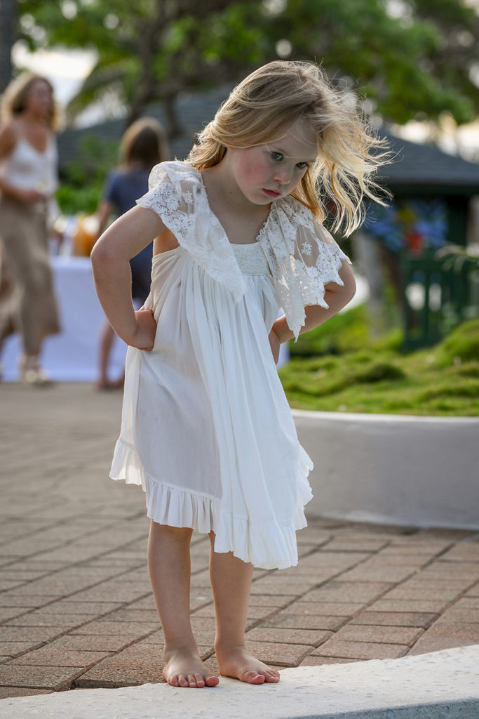 A flower girl dances at the wedding ceremony