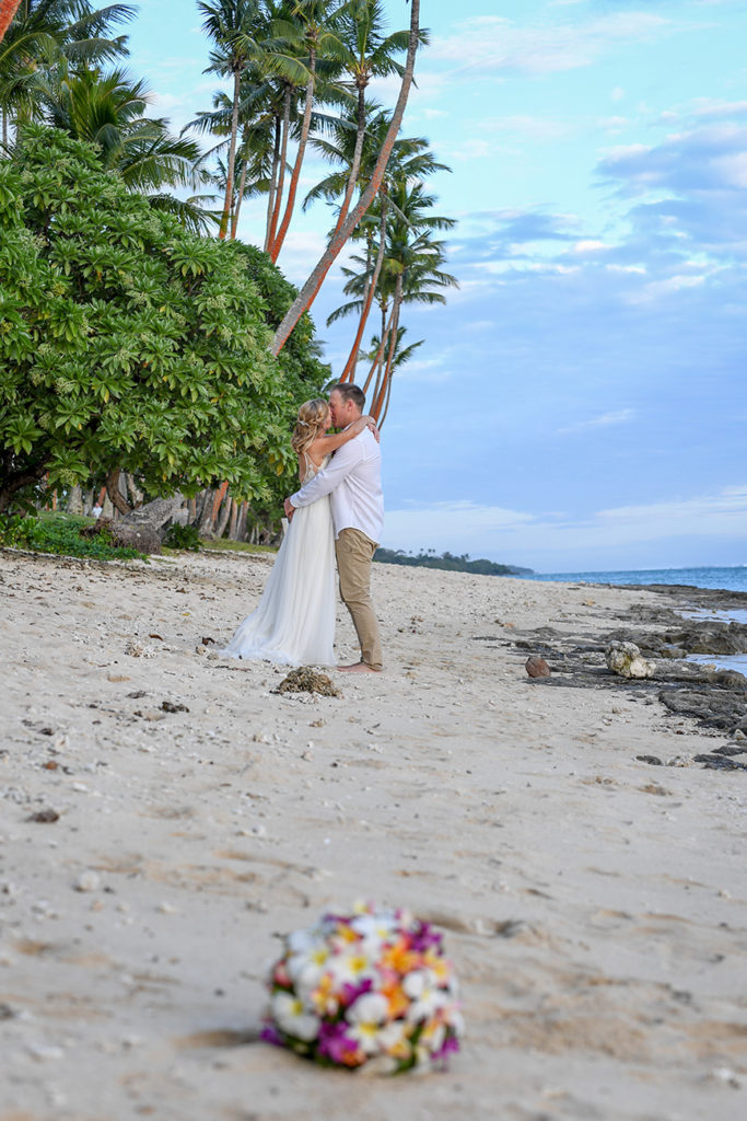 The newly weds share a passionate kiss on Shangri La beach in Fiji