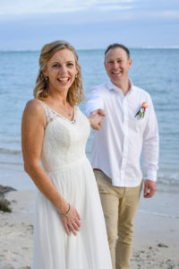 The bride leads her groom while on the Shangri La beach
